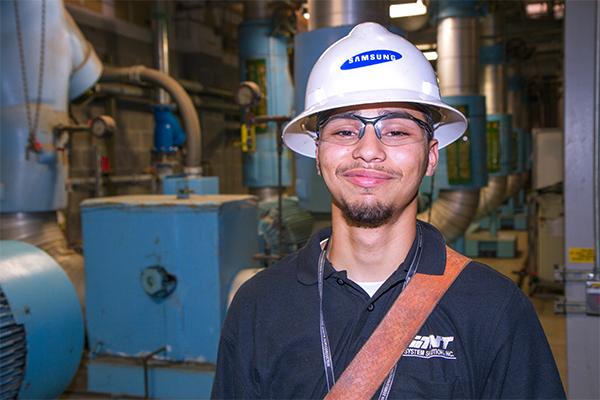 Albert at his job at Samsung.