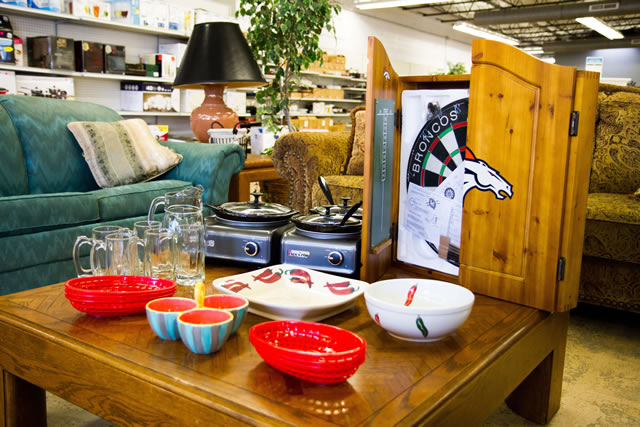 coffee table with serving bowls, broncos dart board