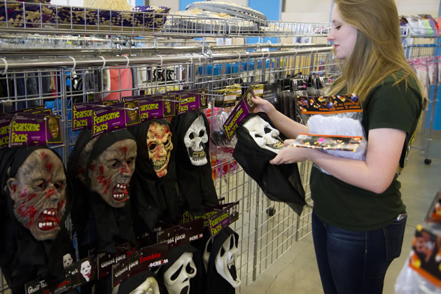 shopper picking out masks