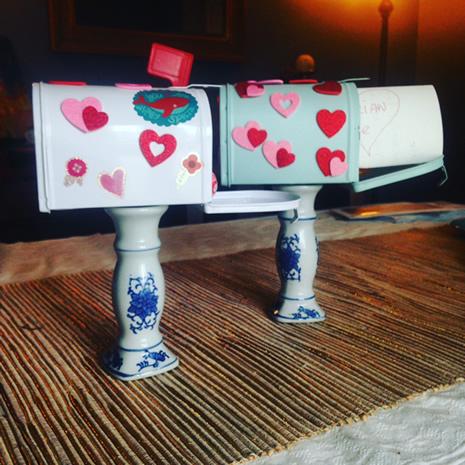 white mailbox with valentine hearts