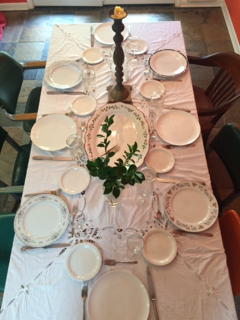 table set with white cloth and china