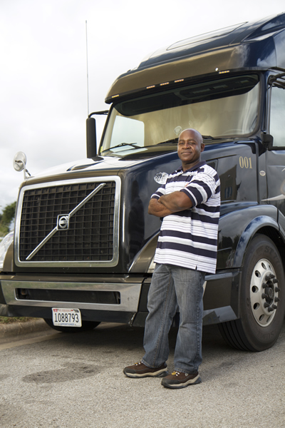 Lynn standing next to his truck