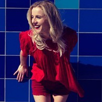 Colby Red Outfit Blue Wall