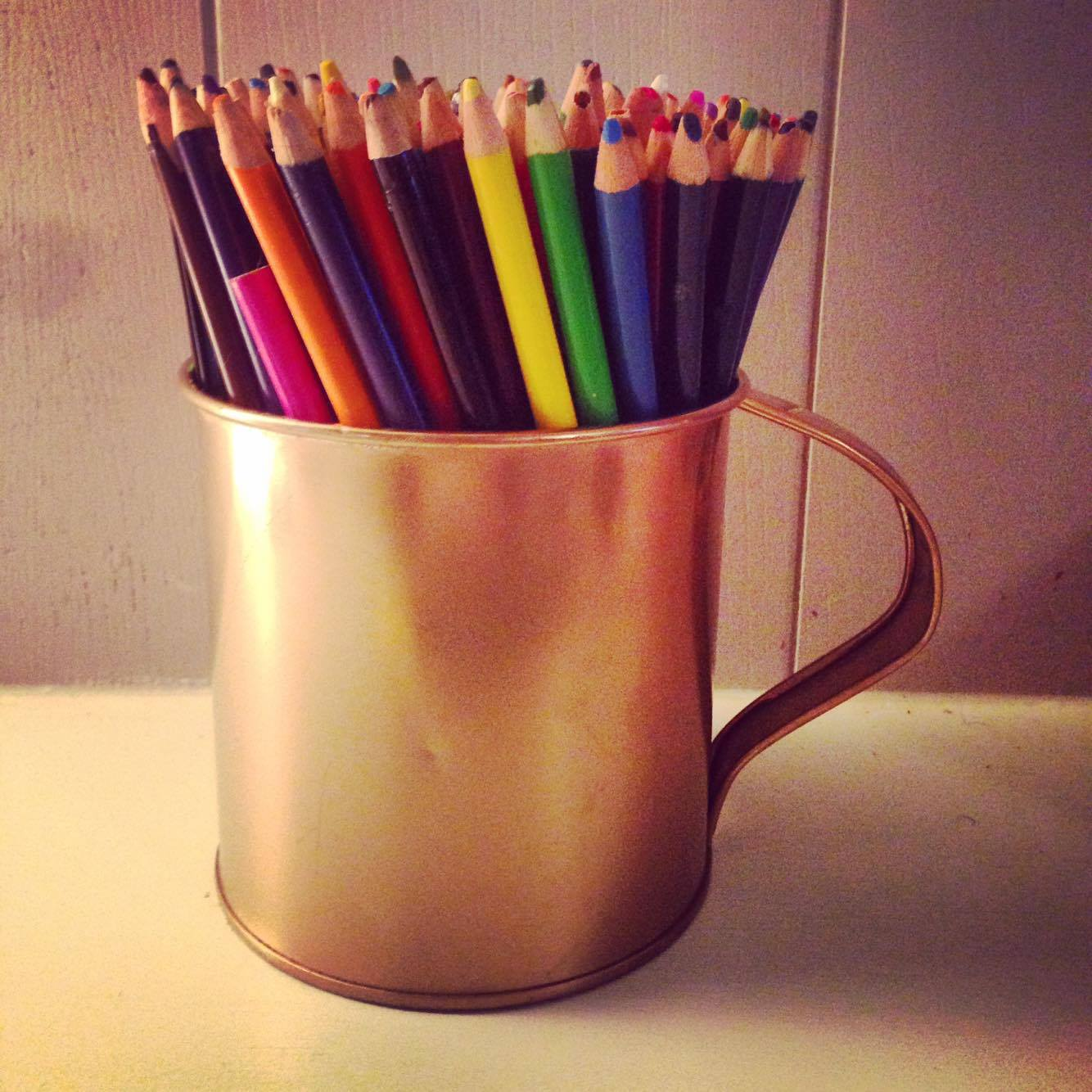 after: gold metal cup with pencils