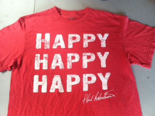 red shirt with the words happy stacked three times