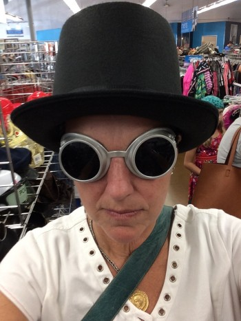 mom trying on hat and goggles