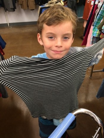 child with black and white striped shirt