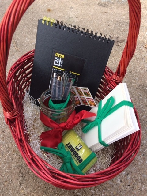 basket with stationary supplies