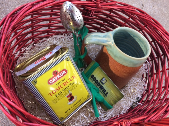 basket with tea, cup & goodwill gift card