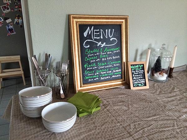 white dishes and chalkboard menu